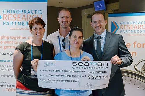 Seaman Chiropractic presents ASRF donation